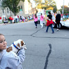 Sophia Simms, 8, holds her bulldog puppy, Jack, as the Batavia High School homecoming parade turns from Wilson Street to Lincoln Street Wednesday evening.
