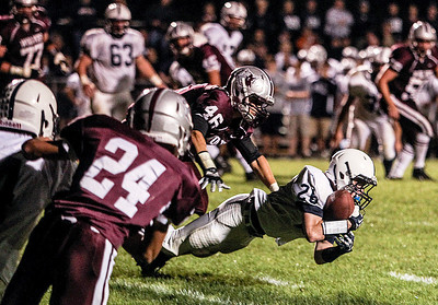 Sarah Nader- snader@shawmedia.com Cary-Grove's Kevin Hughes runs a play during the second quarter of Friday's game against Prairie Ridge September 27, 2013. Cary-Grove defeated Prairie Ridge, 6-0.