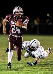 Sarah Nader- snader@shawmedia.com Prairie Ridge's Jacob Reid (left) is tackled by Cary-Grove's Matt Hughes during the third quarter of Friday's game in Crystal Lake September 27, 2013. Cary-Grove defeated Prairie Ridge, 6-0.