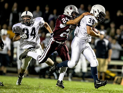 Sarah Nader- snader@shawmedia.com Prairie Ridge's Jacob Reid (left) tackles Cary-Grove's Tyler Pennington during the first quarter of Friday's game in Crystal Lake September 27, 2013. Cary-Grove defeated Prairie Ridge, 6-0.