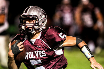 Sarah Nader- snader@shawmedia.com Prairie Ridge's Danny Meikel runs a play during the fourth quarter of Friday's game against Cary-Grove September 27, 2013. Cary-Grove defeated Prairie Ridge, 6-0.