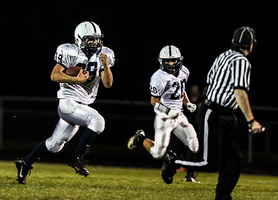 Sarah Nader- snader@shawmedia.com Cary-Grove's Tyler Pennington (left) runs a play during  the first quarter of Friday's game against Prairie Ridge September 27, 2013. Cary-Grove defeated Prairie Ridge, 6-0.