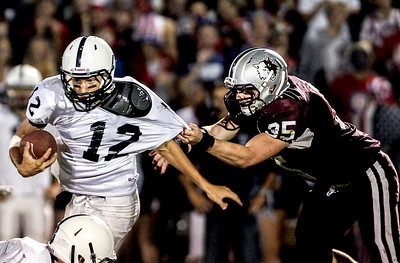 Sarah Nader- snader@shawmedia.com Cary-Grove's quarterback Jason Gregoire (left) is defended by Prairie Ridge's Danny Giffels during the fourth quarter of Friday's game in Crystal Lake September 27, 2013. Cary-Grove defeated Prairie Ridge, 6-0.
