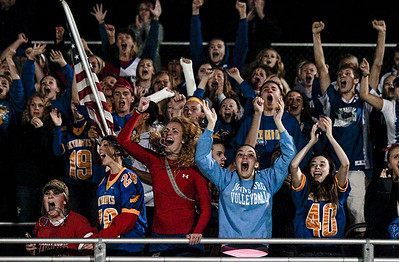 Kyle Grillot - kgrillot@shawmedia.com   Johnsburg fans celebrate after Brad Iverson makes the game-ending interception during the fourth quarter of the high school football game at Woodstock North High School Friday, September 27, 2013. Johnsburg won the game, ending a 25 game losing streak.