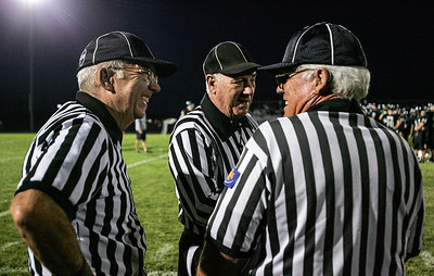 Kyle Grillot - kgrillot@shawmedia.com   Referees talk before the start of the high school football game at Woodstock North High School against Johnsburg Friday, September 27, 2013. Johnsburg won the game, ending a 25 game losing streak.