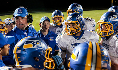 Kyle Grillot - kgrillot@shawmedia.com   Johnsburg head coach Mike Maloney talks with his team during the third quarter of the high school football game at Woodstock North High School Friday, September 27, 2013. Johnsburg won the game, ending a 25 game losing streak.