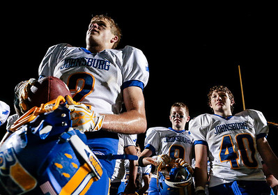Kyle Grillot - kgrillot@shawmedia.com   The Johnsburg team listens to head coach Mike Maloney after winning the high school football game at Woodstock North High School Friday, September 27, 2013. Johnsburg won the game, ending a 25 game losing streak.