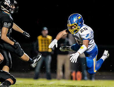 Kyle Grillot - kgrillot@shawmedia.com   Johnsburg junior Branden Peshek dives for a field goal attempt during the first quarter of the high school football game at Woodstock North High School Friday, September 27, 2013. Johnsburg won the game, ending a 25 game losing streak.