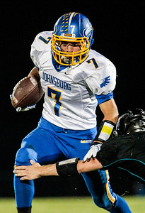 Kyle Grillot - kgrillot@shawmedia.com   Johnsburg senior Alec Graef runs past the Woodstock North defense during the quarter of  high school football game at Woodstock North High School Friday, September 27, 2013. Johnsburg won the game, ending a 25 game losing streak.