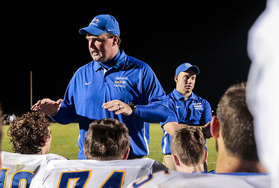 Kyle Grillot - kgrillot@shawmedia.com   Johnsburg head coach Mike Maloney talks with his team after winning the high school football game at Woodstock North High School Friday, September 27, 2013. Johnsburg won the game, ending a 25 game losing streak.