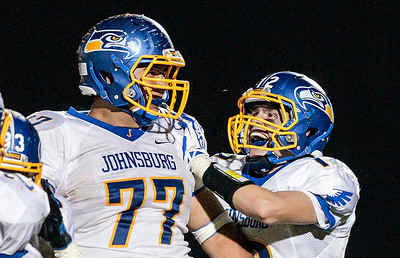 Kyle Grillot - kgrillot@shawmedia.com   Johnsburg senior Zach Kinney (77) is greeted by junior Brad Iverson after Kinney intercepted a ball late in the fourth quarter of the high school football game at Woodstock North High School Friday, September 27, 2013. Johnsburg won the game, ending a 25 game losing streak.