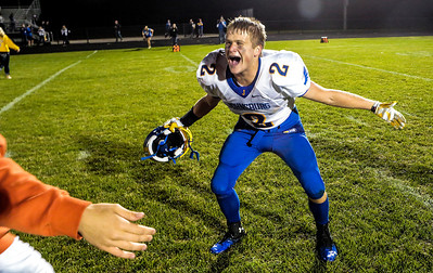 Kyle Grillot - kgrillot@shawmedia.com   Johnsburg senior Steve Dixon (2) is greeted by fans after winning the high school football game against Woodstock North High School Friday, September 27, 2013. Johnsburg won the game, ending a 25 game losing streak.