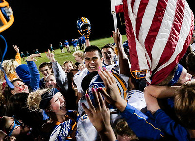 Kyle Grillot - kgrillot@shawmedia.com   The Johnsburg team celebrates with fans after winning the high school football game at Woodstock North High School Friday, September 27, 2013. Johnsburg won the game, ending a 25 game losing streak.