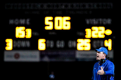Kyle Grillot - kgrillot@shawmedia.com   Johnsburg head coach Mike Maloney yells towards officials during the final minutes of the fourth quarter of the high school football game at Woodstock North High School Friday, September 27, 2013. Johnsburg won the game, ending a 25 game losing streak.