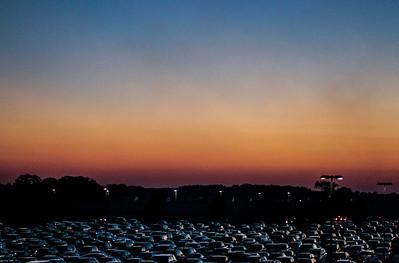 Kyle Grillot - kgrillot@shawmedia.com   Cars fill the parking lot of Woodstock North High School before the start of the high school football game against Johnsburg Friday, September 27, 2013. Johnsburg won the game, ending a 25 game losing streak.