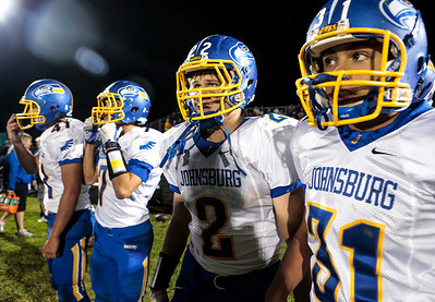 Kyle Grillot - kgrillot@shawmedia.com   Johnsburg senior Steven Dixon (2) and Sophomore Anthony Vallone (31) watch the their tema in the final minutes of the high school football game at Woodstock North High School Friday, September 27, 2013. Johnsburg won the game, ending a 25 game losing streak.