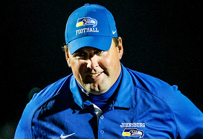 Kyle Grillot - kgrillot@shawmedia.com   Johnsburg head coach Mike Maloney smiles while talking with his team after winning the high school football game at Woodstock North High School Friday, September 27, 2013. Johnsburg won the game, ending a 25 game losing streak.