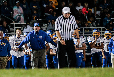 Kyle Grillot - kgrillot@shawmedia.com   A referee smiles as Johnsburg head coach Mike Maloney yells about a call on a play during the third quarter of the high school football game at Woodstock North High School Friday, September 27, 2013. Johnsburg won the game, ending a 25 game losing streak.