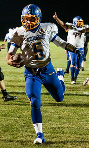 Kyle Grillot - kgrillot@shawmedia.com   Johnsburg junior quarterback Nick Brengman runs the ball in for a touchdown during the third quarter of the high school football game at Woodstock North High School Friday, September 27, 2013. Johnsburg won the game, ending a 25 game losing streak.