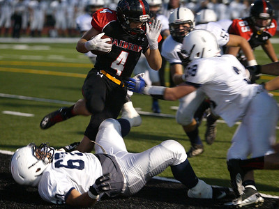 H. Rick Bamman - hbamman@shawmedia.com Huntley's Mitchell Kawell is caught for a safety by Cary-Groves Michael Gomez and Matt Hughes in the first quarter. Cary-Grove stunned Huntley, 16-13, Friday, Sept. 13, 2013.