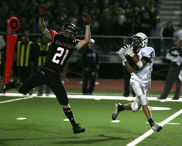 H. Rick Bamman - hbamman@shawmedia.com Cary-Grove's Larkin Hanselmann snags a Jason Gregoire 60-yard pass over Huntley's Connor Boos for a touchdown late in the fourth quarter against Huntley Friday, Sept. 13, 2013.
