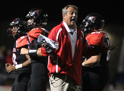H. Rick Bamman - hbamman@shawmedia.com Huntley head coach John Hart questions an official's non-call in the second half Friday, Sept. 13, 2013.