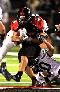 H. Rick Bamman - hbamman@shawmedia.com Huntley's Mitchell Kawell in drags Cary-Groves' Matt Sutherland for a first down in the second quarter Friday, Sept. 13, 2013.