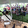 Jeff Krage – For Shaw Media<br /> People gather to listen to Old Lazarus Harp play folk songs during Monday's Fox Valley Folk Music & Storytelling Festival at Island Park in Geneva.<br /> Geneva 9/1/14