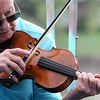 Jeff Krage – For Shaw Media<br /> Ed Cosner plays with Bill Robinson & Friends during Monday's Fox Valley Folk Music & Storytelling Festival at Island Park in Geneva.<br /> Geneva 9/1/14