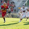 Batavia Running Back Zach Garrett (33) carries the ball against Oswego at Batavia High School in Batavia, IL on Saturday, August 30, 2014 (Sean King for Shaw Media)
