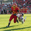 Batavia Running Back Zach Garrett (33) carries the ball against Oswego at Batavia High School in Batavia, IL on Saturday, August 30, 2014 (Sean King for Shaw Media)