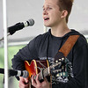 Jeff Krage – For Shaw Media<br /> Chris Fauxe sings while playing the guitar during Monday's Fox Valley Folk Music & Storytelling Festival at Island Park in Geneva.<br /> Geneva 9/1/14