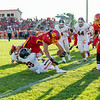 Batavia Runing Back Noah Frazier (44) dives over Oswego Cornerback Willie Rodriguez (28) for a touchdown at Batavia High School in Batavia, IL on Saturday, August 30, 2014 (Sean King for Shaw Media)