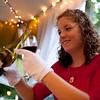 Liz Mullen of Elgin pours Geneva's Wine Celar's Pinot Nior at Gram's wine tent during Festival of the Vine in Geneva on Friday, Sept. 5.