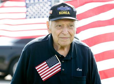 H. Rick Bamman - hbamman@shawmedia.com   Korean war Veteran Carl Menconi of Elgin helped welcome home Spc. Tim Carner and his family to Woodstock.