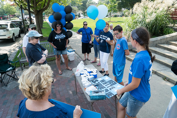 Supporters gather blue lights, signs and blue ribbon for a rally to support local law enforcement in front of the Old Kane County Court House in Geneva, IL on Sunday, September 06, 2015 (Sean King for Shaw Media)