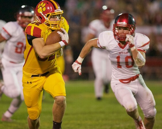 Karen Naess For The Kane County Chronicle<br />   Batavia's Ethan Hallberg carries the ball as South Elgin's Justin Nutof looks for the stop on Friday in Batavia.