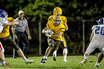 Ken Koontz-For Shaw Media  Jacob's Loren Strickland (5) runs up the middle September 2, 2016 at Jacob's High School in Algonquin. Jacpb's went on to win the game 14-0.