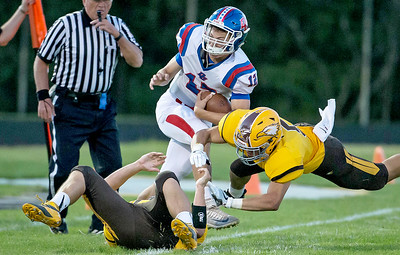 Ken Koontz-For Shaw Media  Jacob's Loren Strickland (5) lays a big hit on Dundee-Crown's Conor Ryan (12) September 2, 2016 at Jacob's High School in Algonquin. Jacpb's went on to win the game 14-0.
