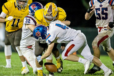 Ken Koontz-For Shaw Media  Dundee-Crown's Johnathan Mays (4) forces a turnover from Jacob's David Butros(34) September 2, 2016 at Jacob's High School in Algonquin. Jacpb's went on to win the game 14-0.
