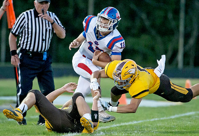Ken Koontz-For Shaw Media  Jacob's Loren Strickland (5) lays a big hit on Dundee-Crown's Conor Ryan (12) Friday, Sept. 2, 2016 at Jacobs' High School in Algonquin. Jacob's went on to win the game 14-0.