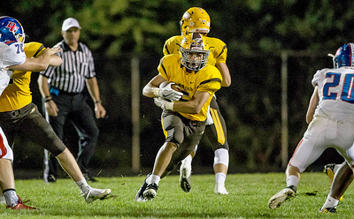 Ken Koontz-For Shaw Media  Jacobs' Loren Strickland (5) runs up the middle Friday, Sept. 2, 2016 at Jacob's High School in Algonquin. Jacobs went on to win the game 14-0.