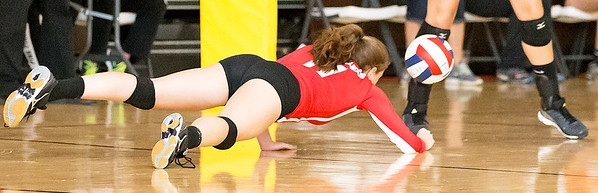 Marion Central Catholics' Meghan Schwallie (11) dives in an attempt to save the point Saturday, Sept 3rd at the Jacob Varsity Volleyball Innovational held at Jacobs High School in Algonquin. Marion went on to take first place in the tournament. Ken Koontz – For Shaw Media