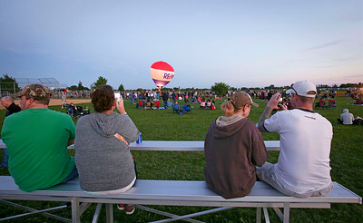 Spectators watch the loan Hot Air Balloon during the  Balloon Night Glow at the inaugural Harvard Balloon Fest on Saturday, September 3, 2016 in Harvard, Ill. John Konstantaras photo for the Northwest Herald