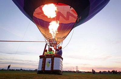 The ReMax Hot Air Balloon pumps a little hot air during the  Balloon Night Glow at the inaugural Harvard Balloon Fest on Saturday, September 3, 2016 in Harvard, Ill. John Konstantaras photo for the Northwest Herald
