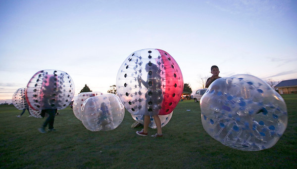 Kids play Knockerball at the inaugural Harvard Balloon Fest on Saturday, September 3, 2016 in Harvard, Ill. John Konstantaras photo for the Northwest Herald