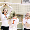 St. Charles East's Ilona Willsey, left, and Kyra Slavik, right, celebrate a point during a match at Batavia on Sept. 6.