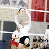 St. Charles East's Morgan Kull sets the ball during a match at Batavia on Sept. 6.