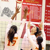 St. Charles East's Kyla Augustine goes up for a kill during a match at Batavia on Sept. 6.