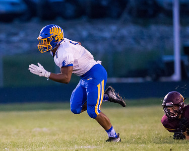 Johnsburg's Alex Peete breaks a tackle on his way to the endzone Friday, Sept. 9, 2016 at Richmond-Burton High School in Richmond. Johnsburg wins 53-0.